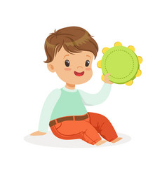 cute little boy playing tambourine young musician vector image