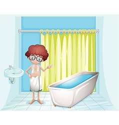A boy standing inside the comfort room vector