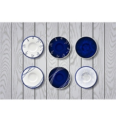Blue plate with flowers ornament on white wooden vector