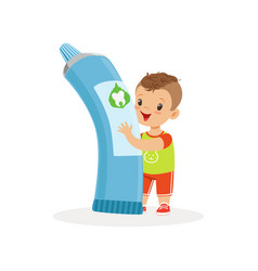 cute little boy standing and holding big tube of vector image vector image