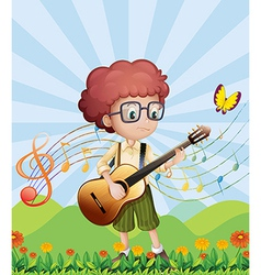 A boy with his guitar at the hills vector image vector image