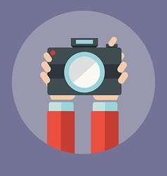 Hands holding camera vector