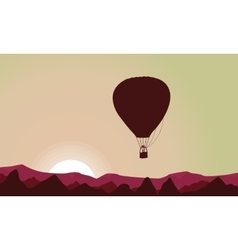 Hill landscape with hot air balloon silhouettes vector