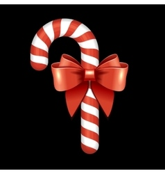 Christmas candy cane with red ribbon vector