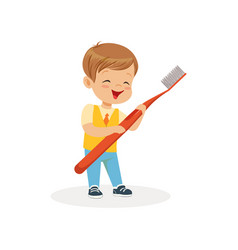 smiling boy standing with big toothbrush cute vector image