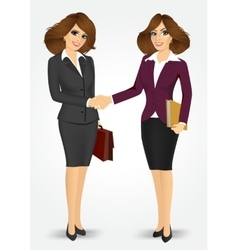 two businesswomen shaking hands vector image