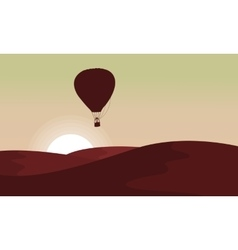 Silhouette of desert with air balloon in the sky vector image