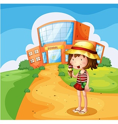 A girl eating an ice cream near the school vector image