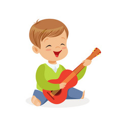Cute little boy sitting on the floor playing vector