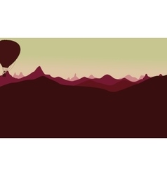 Silhouette of mountain landscape with air balloon vector image