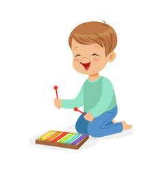 cute little boy playing xylophone young musician vector image