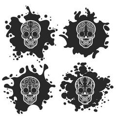 ornate skulls on black ink splashes vector image