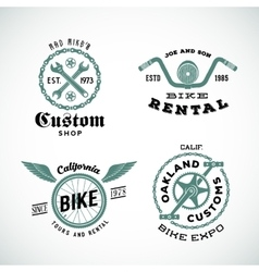 Set of retro bicycle custom labels or logos vector
