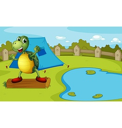 A turtle beside the pond inside a fence vector