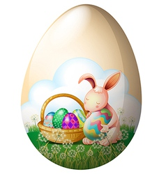 An easter bunny with easter eggs vector