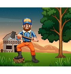 A lumberjack standing near the tree while holding vector image vector image