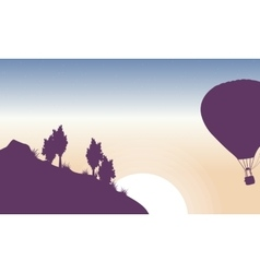 Hot air balloon in the sky of silhouette vector