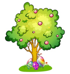 A bunny and eggs under the tree vector
