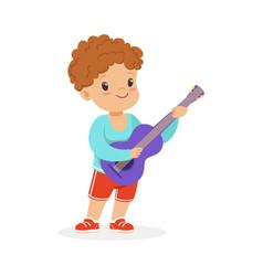 Cute little boy playing guitar young musician vector