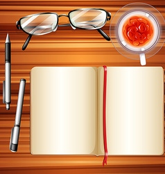 Notebook and ice tea on table vector