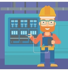 Electrician with electrical equipment vector