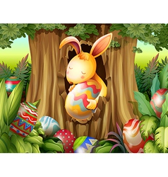 A rabbit inside the hole of a tree surrounded with vector