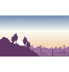 Silhouette of hill with bridge landscape vector