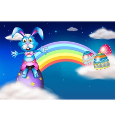 An easter bunny and eggs near the rainbow vector