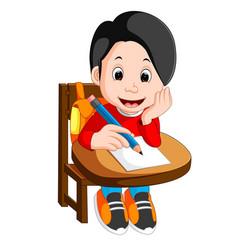 Happy schoolboy writing in class vector