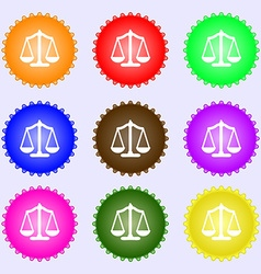 Scales balance a set of nine different colored vector
