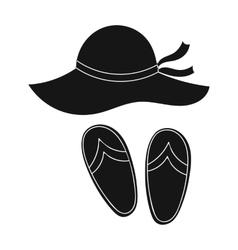 Beach hat with flip-flops icon in black style vector