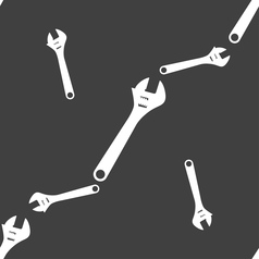 Wrench icon sign seamless pattern on a gray vector
