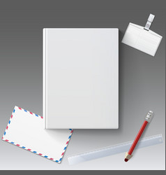 Blank book cover with stationery vector image