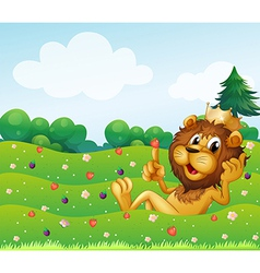 A king lion at the top of the hill vector