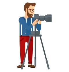 Photographer working with camera vector