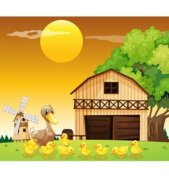 A duck and her ducklings outside the farmhouse vector