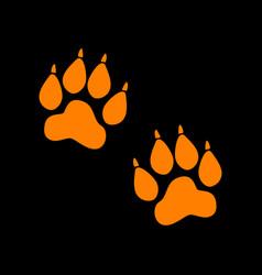 animal tracks sign orange icon on black vector image vector image