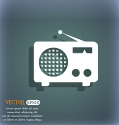 Retro radio icon on the blue-green abstract vector