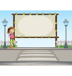 A girl beside a blank signage in the street vector