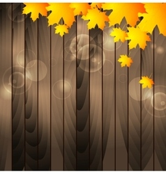 Autumn maple leaves on wooden background vector