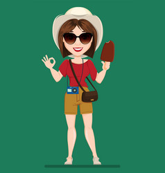 Tourist woman traveler in sunglasses holding vector