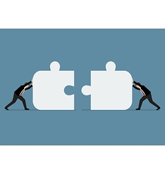 Businessmen pushing two jigsaw pieces together vector