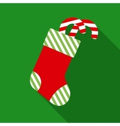 Christmas sock with candy cane in flat style vector