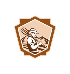 Organic farmer farm pitchfork shield vector