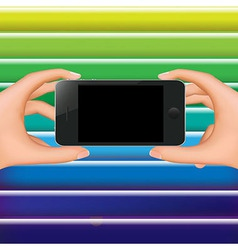 Hands Holding Phone And Color Background vector image