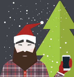 Man dressed like santa claus holds smartphone vector