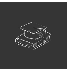 Graduation cap laying on book drawn in chalk icon vector