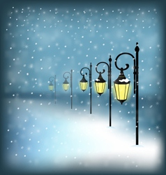 Lanterns stand in snowfall on blue vector