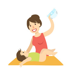 Mother changing nappy to a baby on changing table vector