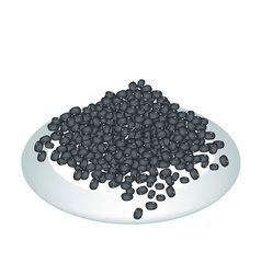 A lot of black beans on white plate vector